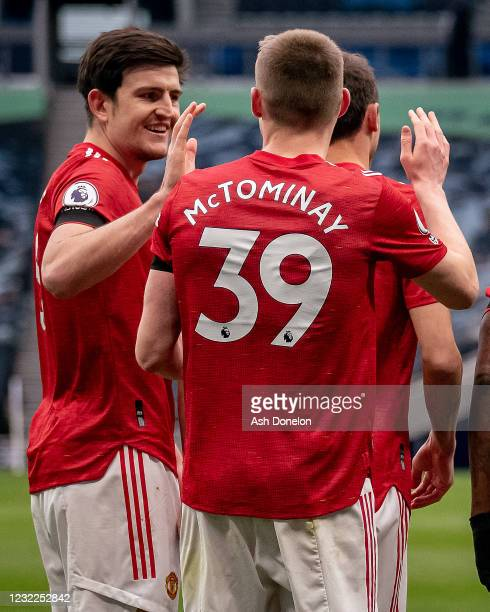 Scott McTominay of Manchester United celebrates with Harry Maguire at the end of the Premier League match between Tottenham Hotspur and Manchester...