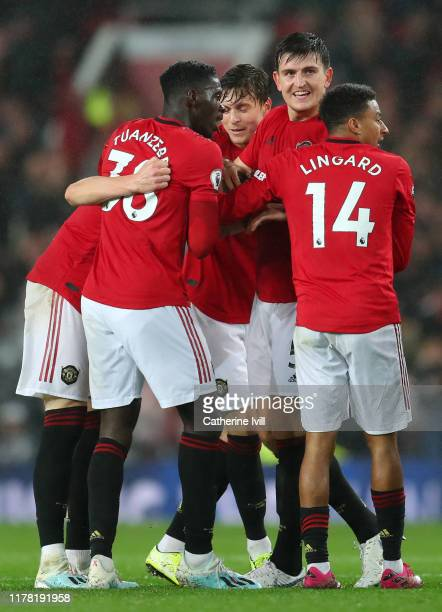 Scott McTominay of Manchester United celebrates with his team after scoring his teams first goal during the Premier League match between Manchester...