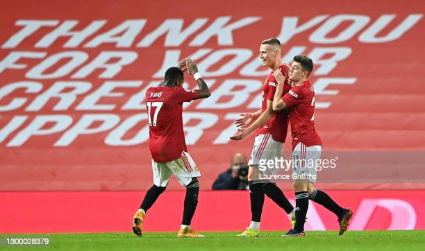 Scott McTominay of Manchester United celebrates with team mates Fred and Daniel James after scoring their side's sixth goal during the Premier League...