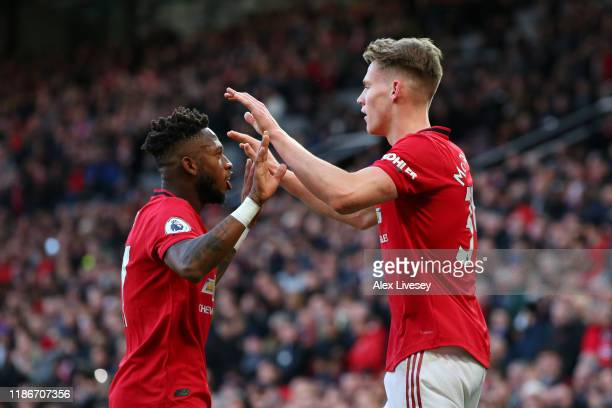 Scott McTominay of Manchester United celebrates with teammate Fred after their team's second goal, an own goal from Davy Propper of Brighton and Hove...