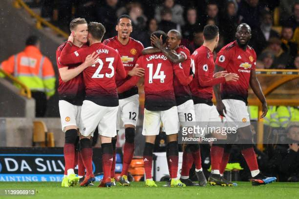 Scott McTominay of Manchester United celebrates with teammates after scoring his team's first goal during the Premier League match between...
