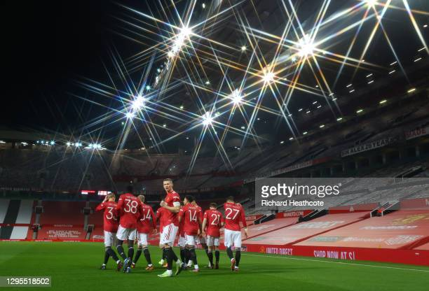 Scott McTominay of Manchester United celebrates with teammates after scoring their team's first goal during the FA Cup Third Round match between...