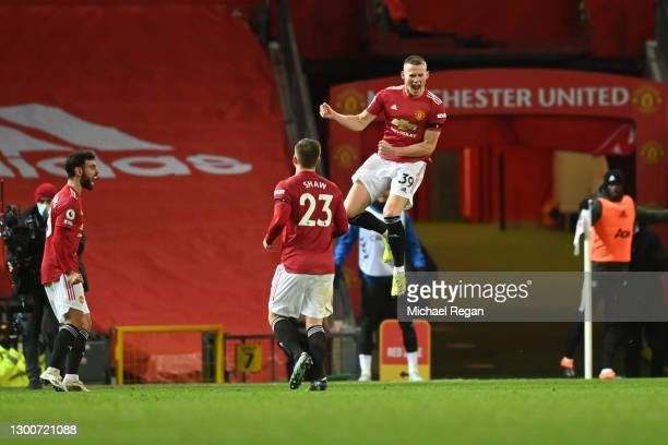 Scott McTominay of Manchester United celebrates with teammates Bruno Fernandes and Luke Shaw after scoring their team's third goal during the Premier...