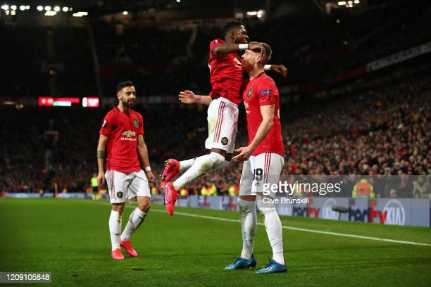 Scott McTominay of Manchester United celebrates with teammates Fred and Bruno Fernandes of Manchester United after scoring his team's third goal...