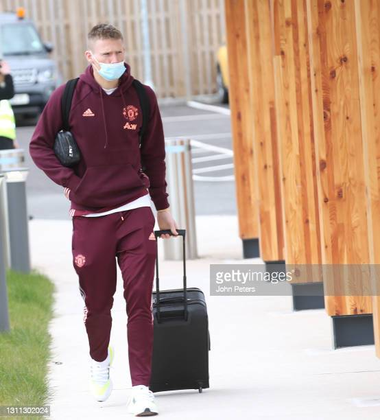Scott McTominay of Manchester United checks in ahead of their flight to Granada at Manchester Airport on April 07, 2021 in Manchester, England.