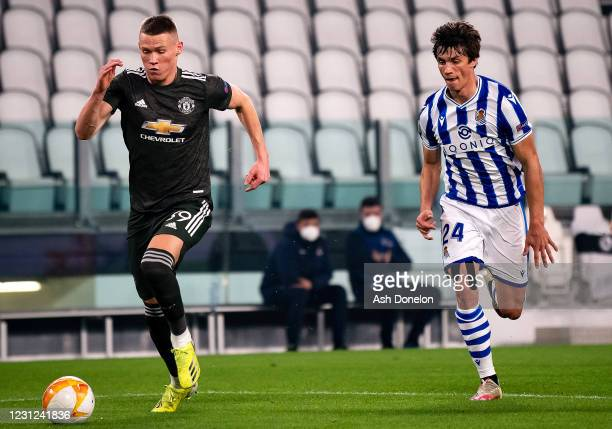 Scott McTominay of Manchester United competes with Robin Le Normand of Real Sociedad during the UEFA Europa League Round of 32 match between Real...