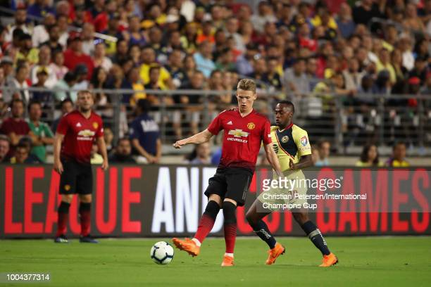 Scott Mctominay of Manchester United conrols the ball past Renato Ibarra of Club America during the International Champions Cup game at the...