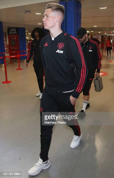 Scott McTominay of Manchester United departs from Manchester Airport ahead of the preseason friendly match between Bayern Munich and Manchester...