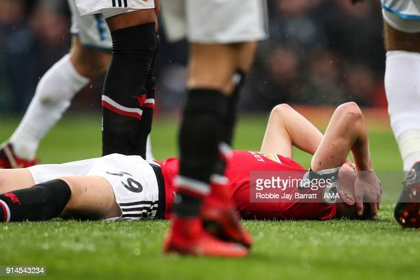 Scott McTominay of Manchester United down injured during the Premier League match between Manchester United and Huddersfield Town at Old Trafford on...
