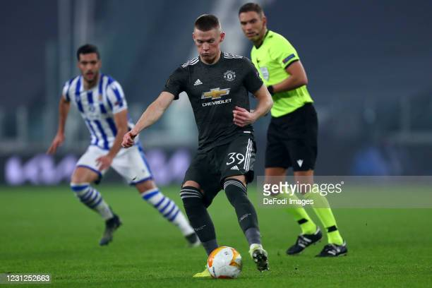Scott McTominay of Manchester United Fc controls the ball during the UEFA Europa League Round of 32 match between Real Sociedad and Manchester United...