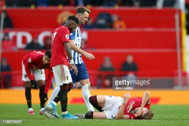 Scott McTominay of Manchester United goes down injured during the Premier League match between Manchester United and Brighton Hove Albion at Old...