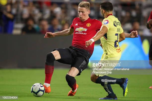Scott McTominay of Manchester United handles the ball against Henry Martin of Club America during the International Champions Cup game at the...
