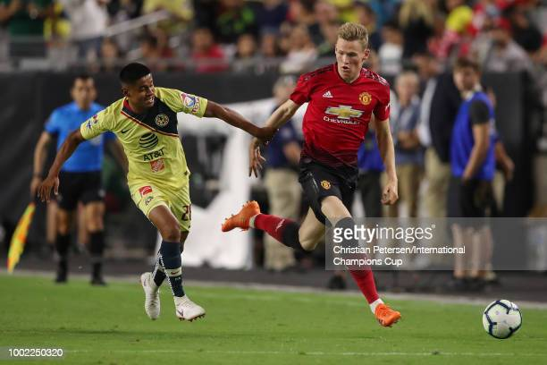Scott McTominay of Manchester United handles the ball in front of Jose Guillen of Club America during the International Champions Cup game at the...
