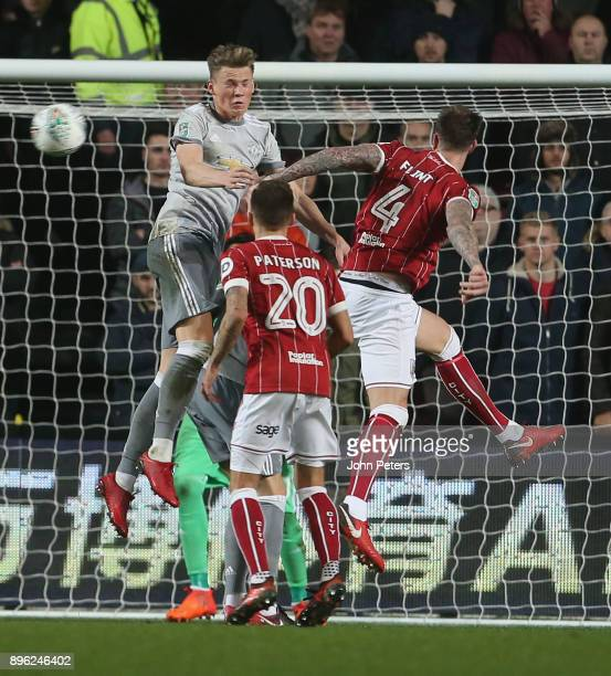 Scott McTominay of Manchester United in action with Aden Flint and Jamie Paterson of Bristol City during the Carabao Cup QuarterFinal match between...