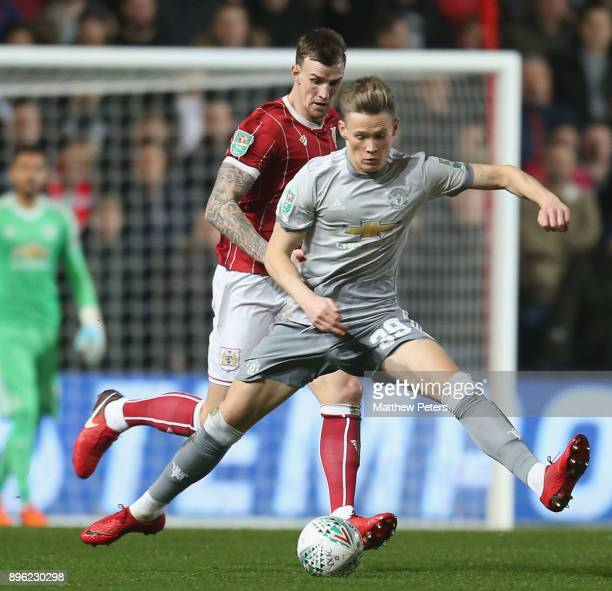 Scott McTominay of Manchester United in action with Aden Flint of Bristol City during the Carabao Cup QuarterFinal match between Bristol City and...