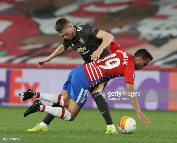Scott McTominay of Manchester United in action with Angel Montoro of Granada CF during the UEFA Europa League Quarter Final First Leg match between...