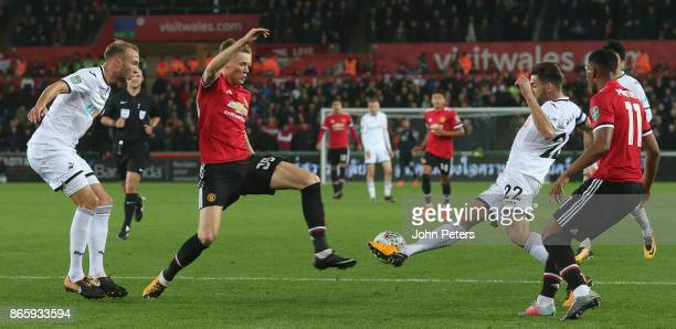 Scott McTominay of Manchester United in action with Angel Rangel of Swansea City during the Carabao Cup Fourth Round match between Swansea City and...