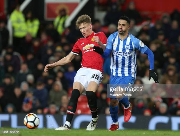 Scott McTominay of Manchester United in action with Beram Kayal of Brighton Hove Albion during the Emirates FA Cup Quarter Final match between...