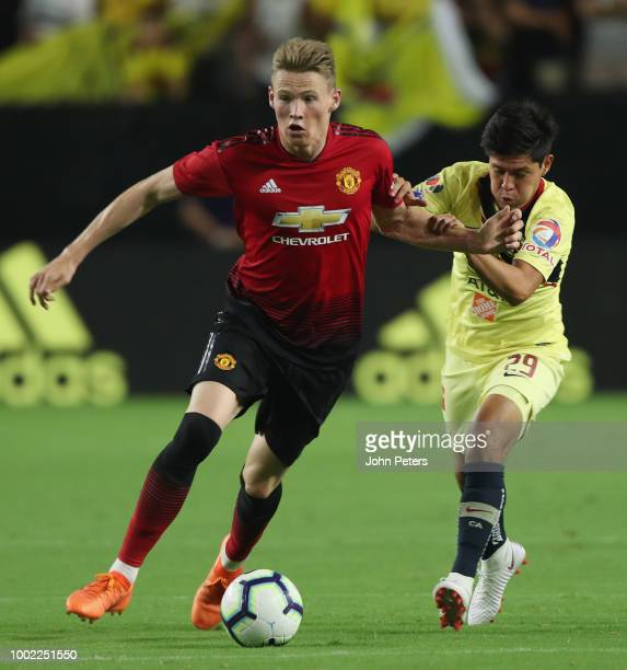 Scott McTominay of Manchester United in action with Brandon Garcia of Club America during the preseason friendly match between Manchester United and...