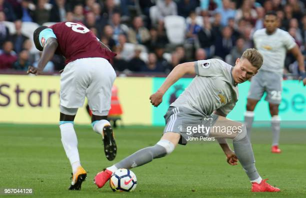 Scott McTominay of Manchester United in action with Cheikhou Kouyate of West Ham United during the Premier League match between West Ham United and...