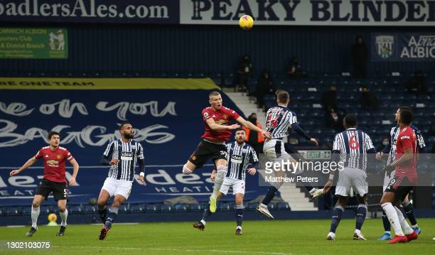 Scott McTominay of Manchester United in action with Conor Townsend of West Bromwich Albion during the Premier League match between West Bromwich...