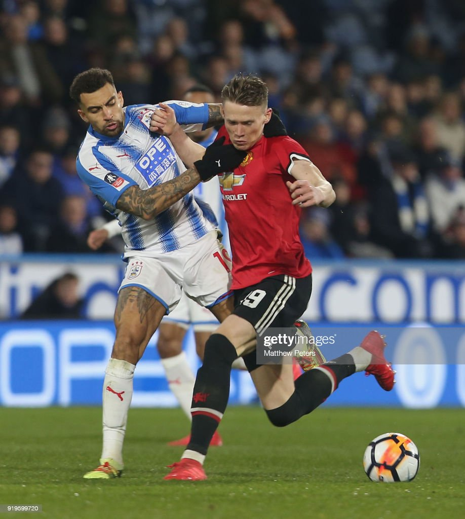 Scott McTominay of Manchester United in action with Danny Williams of Huddersfield Town during the Emirates FA Cup Fifth Round match between Huddersfield Town and Manchester United at Kirklees Stadium on February 17, 2018 in Huddersfield, United Kingdom.