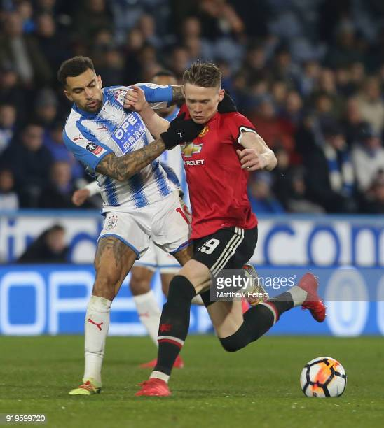 Scott McTominay of Manchester United in action with Danny Williams of Huddersfield Town during the Emirates FA Cup Fifth Round match between...