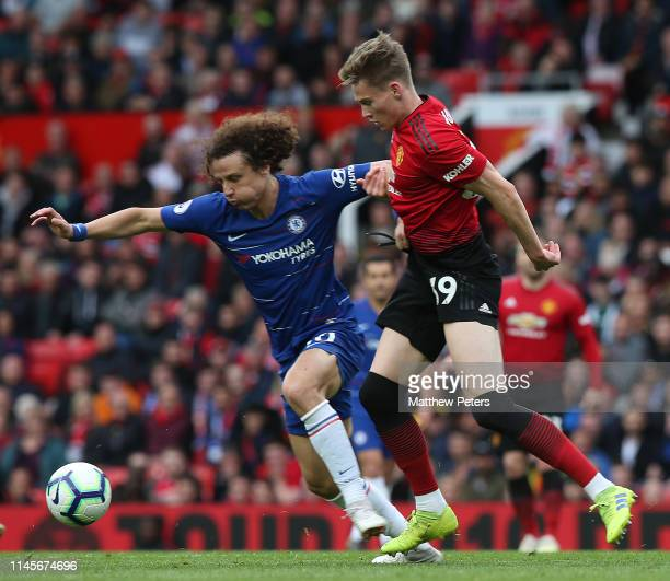 Scott McTominay of Manchester United in action with David Luiz of Chelsea during the Premier League match between Manchester United and Chelsea FC at...