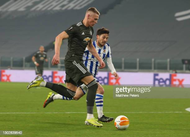 Scott McTominay of Manchester United in action with David Silva of Real Sociedad during the UEFA Europa League Round of 32 match between Real...