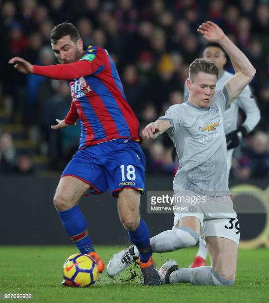 Scott McTominay of Manchester United in action with James McArthur of Crystal Palace during the Premier League match between Crystal Palace and...