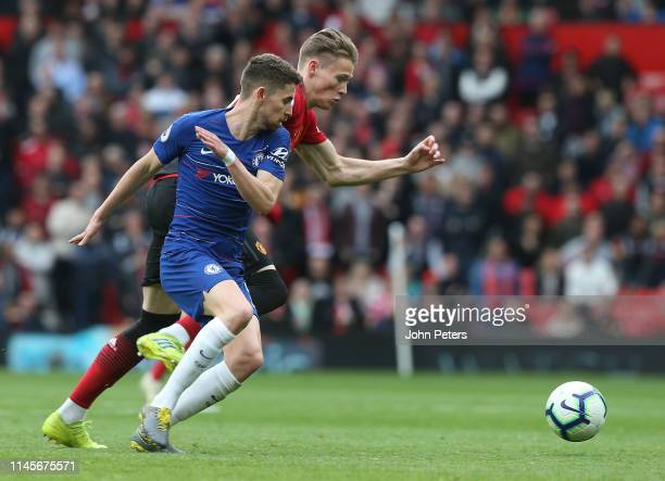 Scott McTominay of Manchester United in action with Jorginho of Chelsea during the Premier League match between Manchester United and Chelsea FC at...