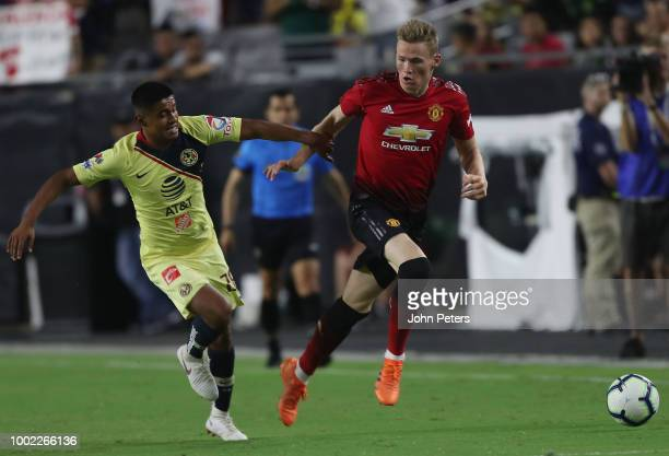 Scott McTominay of Manchester United in action with Jose Guillen of Club America during the preseason friendly match between Manchester United and...