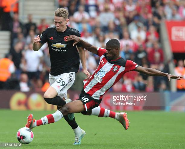 Scott McTominay of Manchester United in action with Kevin Danso of Southampton during the Premier League match between Southampton FC and Manchester...