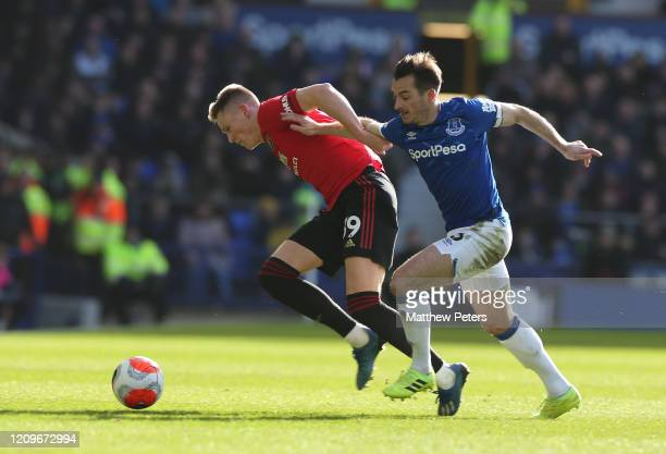 Scott McTominay of Manchester United in action with Leighton Baines of Everton during the Premier League match between Everton FC and Manchester...