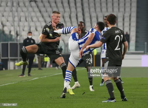Scott McTominay of Manchester United in action with Mikel Merino of Real Sociedad during the UEFA Europa League Round of 32 match between Real...
