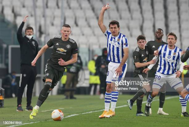 Scott McTominay of Manchester United in action with Mikel Oyarzabal and Nacho Monreal of Real Sociedad during the UEFA Europa League Round of 32...