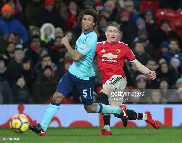 Scott McTominay of Manchester United in action with Nathan Ake of AFC Bournemouth during the Premier League match between Manchester United and AFC...