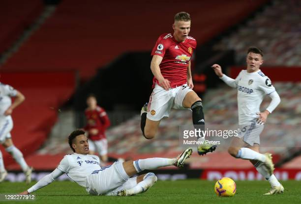 Scott McTominay of Manchester United in action with Pascal Struijk of Leeds United during the Premier League match between Manchester United and...