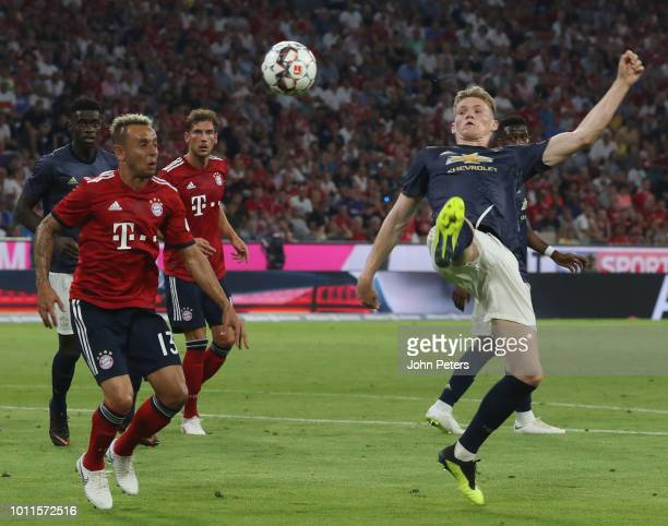 Scott McTominay of Manchester United in action with Rafinha of Bayern Munich during the preseason friendly match between Bayern Munich and Manchester...