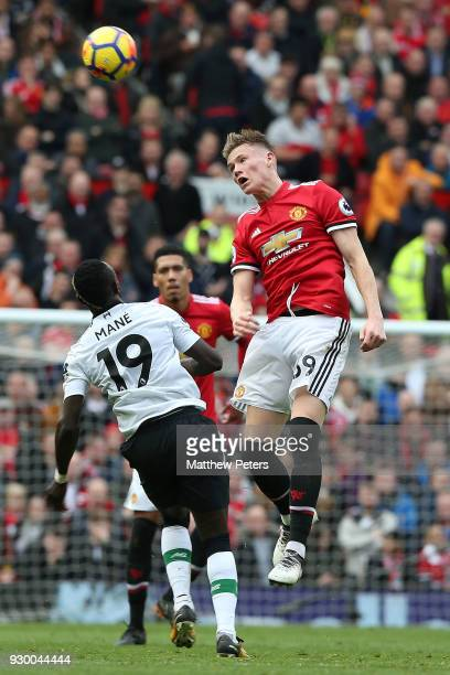 Scott McTominay of Manchester United in action with Sadio Mane of Liverpool during the Premier League match between Manchester United and Liverpool...