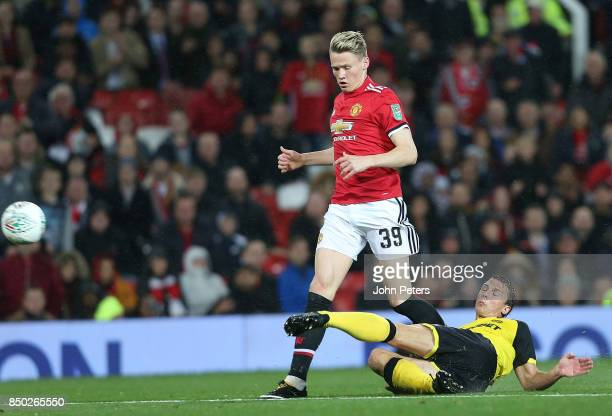 Scott McTominay of Manchester United in action with Stephen Warnock of Burton Albion during the Carabao Cup Third Round match between Manchester...