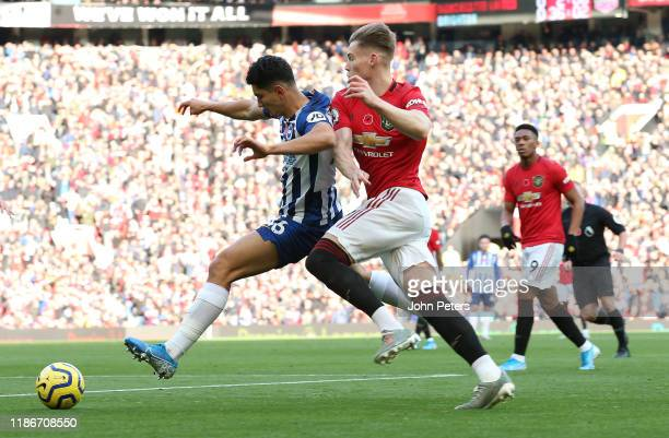 Scott McTominay of Manchester United in action with Steven Alzate of Brighton and Hove Albion during the Premier League match between Manchester...