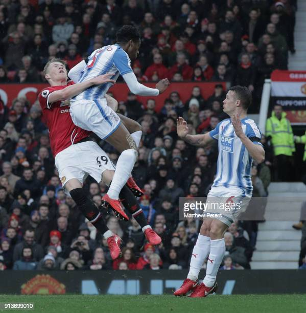 Scott McTominay of Manchester United in action with Terence Kongolo of Huddersfield Town during the Premier League match between Manchester United...