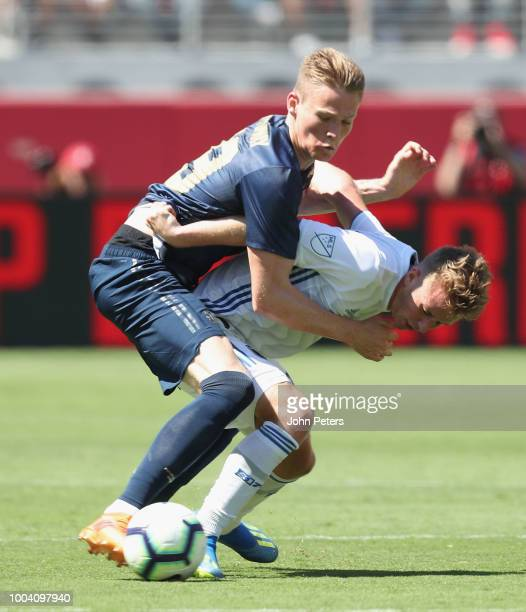 Scott McTominay of Manchester United in action with Tommy Thompson of San Jose Earthquakes during the preseason friendly match between Manchester...