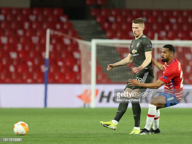 Scott McTominay of Manchester United in action with Yangel Herrera of Granada CF during the UEFA Europa League Quarter Final First Leg match between...
