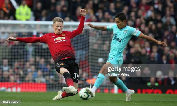 Scott McTominay of Manchester United in action with Yoshinori Muto of Newcastle United during the Premier League match between Manchester United and...