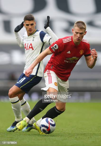 Scott McTominay of Manchester United is challenged by Erik Lamela of Tottenham Hotspur during the Premier League match between Tottenham Hotspur and...