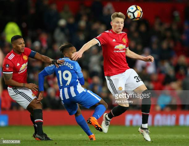 Scott McTominay of Manchester United is challenged by Jose Izquierdo during the Emirates FA Cup Quarter Final between Manchester United and Brighton...