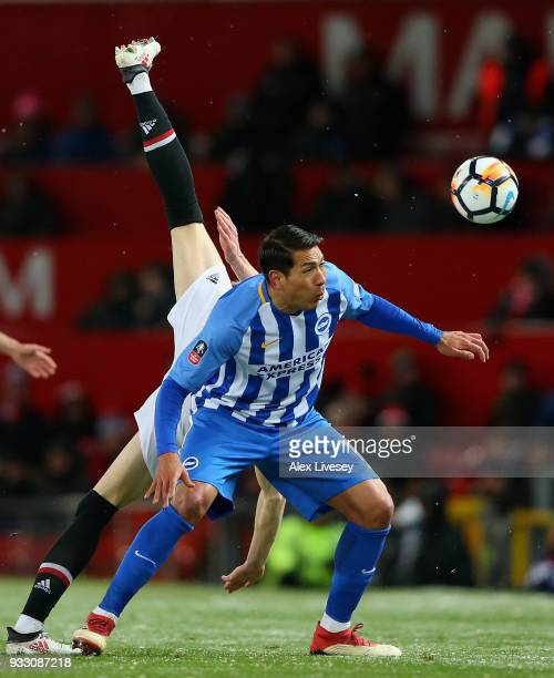 Scott McTominay of Manchester United is challenged by Leonardo Ulloa of Brighton during the Emirates FA Cup Quarter Final between Manchester United...