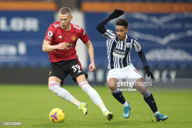 Scott McTominay of Manchester United is challenged by Matheus Pereira of West Bromwich Albion during the Premier League match between West Bromwich...